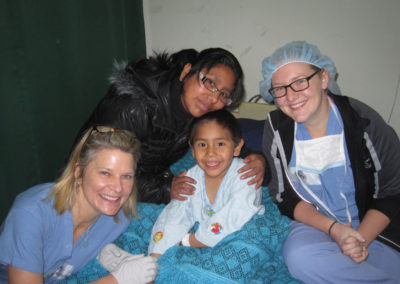 A Happy Patient with his Mother. Laurie Diamond, RN, and Emma Hershey, Translator, Prepare the Patient for Surgery