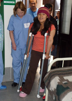 Andrea Serdar supervises Maria Eleana's walk. She will be discharged from the Clinic today