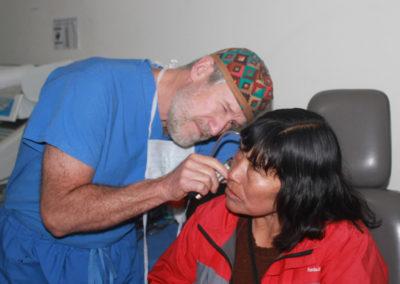 Dr. Brock Examining a Patient