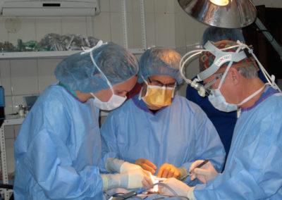 Dr. Brock and Teammates Performing Surgery