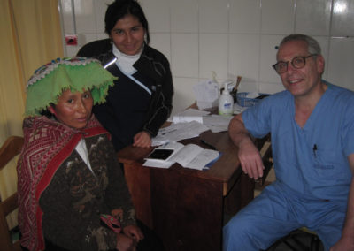 Dr. Gene Aron with the Assistance of Local Clinic Nurse Mery Alvarado Screening a Pre operative Patient