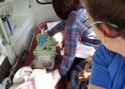 Dr. Karoline Brock and Respiratory Therapist Jessica Purvisk Accompanying Peruvian Neonates During Emergency Transport to Cusco