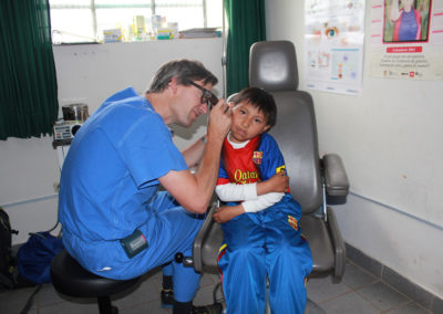 Dr. Long Conducts an Ear Exam on a Young Patient