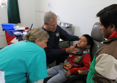Dr.-Mitch-Brock-Conducting-an-Exam-on-a-Patient-while-Translator-Beverly-Elder-of-the-Clinic-