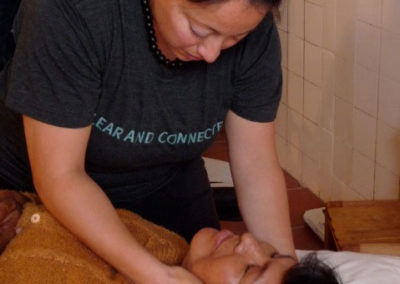Dr. Robles-Arizmend Delivering a Gentle Adjustment at the Kausay Wasi Clinic
