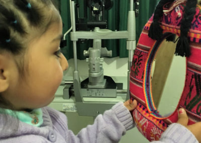 Girl with Exotropic Eyes Looking into Mirror