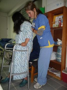 One day after surgery, Jennifer Frydl helps Maria Elena walk