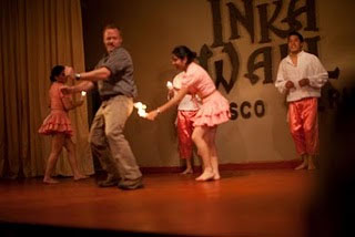 Scott dances with the locals at a dinner presentation