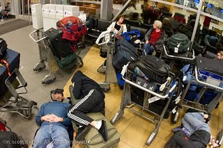 Spending a cozy night at the Lima Airport using luggage as mattresses