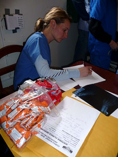 Stephanie Brenden takes notes as patients are triaged