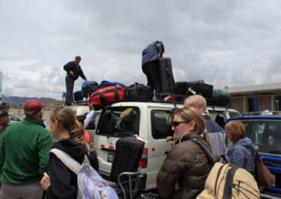The gear and team are loaded onto vans for an hour ride to Coya