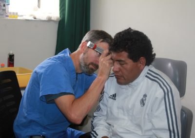 Dr. Long Conducting a Pre-operative Ear Exam