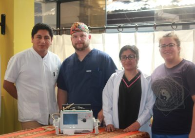Jason and Amanda Royse (far Right) and Clinic Staff with the Defibulator the Royse's Donated to the Clinic