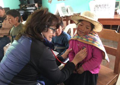 Dr. Karoline Brock Examining a Smiling Girl in Chaypa