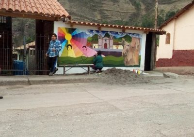 Mural with the Artist Painting Children on It