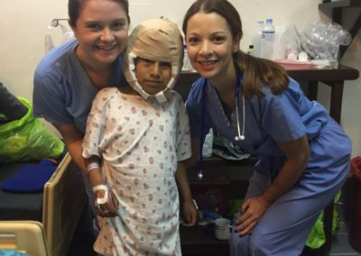 Taylor Frazier and Iolanda Camera Cheering up a Little Boy after Dr. Hong Corrected an Ear Deformity