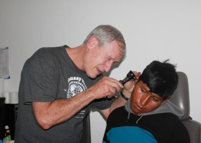 Dr. Mitch Brock Conducting an Ear Exam