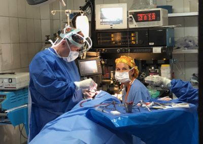 Dr. Mitch Brock Removing Nasal Polyps from a Patient While Lisa Harrison Monitors Anesthesia