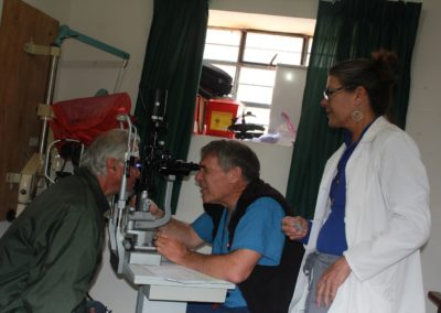 Dr. Paul Schultz and Char Cooke Performing a Glaucoma Exam