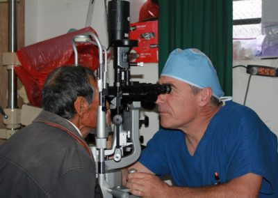 Dr. Schultz Examing the Lens of a Patient after Cataract Surgery