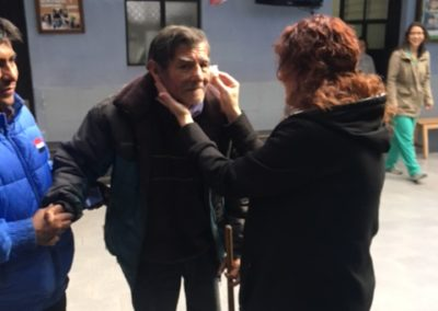 Janice Boucher Dapping a Patient's Eye after Applying Eye Drops